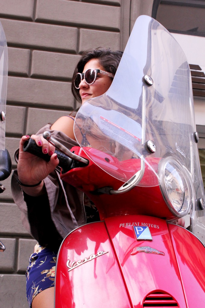 Frances on a red vespa