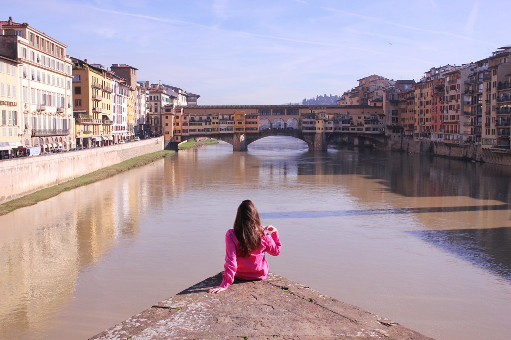 Ponte alla Carraia looking at Ponte Vecchio, kissing in Florence